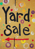 Brightly colored yard sale sign. On cardboard Stock Photo