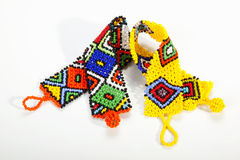 Brightly Colored Zulu Beaded Wristbands in Shape of Aids Ribbons Stock Photos