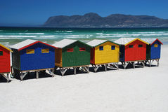 Beach huts in Muizenberg, South Africa. Brightly colorful beach cabins in Muizenberg, Western Cape, South Africa Royalty Free Stock Photo