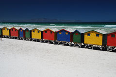 Brightly colorful beach huts in Muizenberg, South. Brightly colorful beach cabins in Muizenberg, Western Cape, South Africa Royalty Free Stock Photo