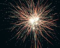 Brightly colorful explosive fireworks light up the night sky at New Year`s eve celebrations. Happy New Year 2017 and holidays Stock Image