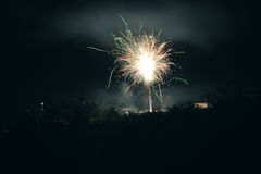 Brightly colorful explosive fireworks light up the night sky at New Year`s eve celebrations. Happy New Year 2017 and holidays Royalty Free Stock Photography