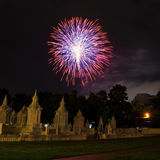 Brightly colorful fireworks colors in the night sky.  Royalty Free Stock Photography