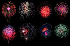 Brightly colorful fireworks in night sky Stock Photos