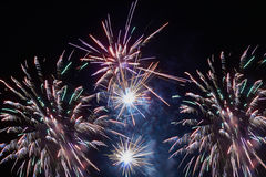 Brightly colorful fireworks and salute. Of various colors in the night sky Royalty Free Stock Photography