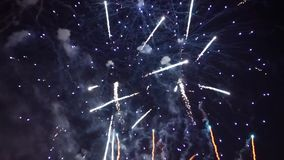 Brightly colorful fireworks and salute of various colors in the night sky stock video