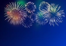 Brightly Colorful Fireworks. On twilight background Stock Image