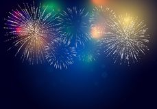 Brightly Colorful Fireworks. On twilight background Royalty Free Stock Image