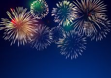 Brightly Colorful Fireworks. On twilight background Stock Photography