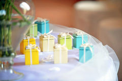 Brightly colorful little party favors on a table Stock Photos