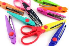 Brightly colors craft scissors on a white background Royalty Free Stock Photography
