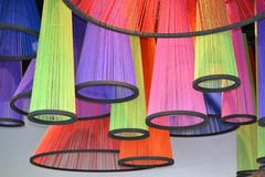 Brightly coloured asian handmade traditional lampshades exposed at the exhibition. Brightly coloured asian handmade traditional lampshades made of stripes royalty free stock photos