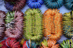 Brightly coloured bangles at a market Stock Images