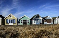 Brightly Coloured Beach Huts. Row of beach huts at Hengistbury Head near Christchurch in Dorset Stock Image