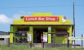 Brightly coloured cafe / shop in rural area on the Wild Coast near Morgan Bay, Transkei South Africa. Brightly coloured cafe / shop in rural area on the Wild royalty free stock images