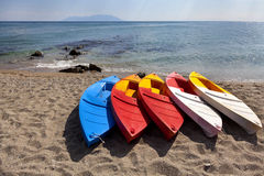 Brightly Coloured Canoes Royalty Free Stock Image