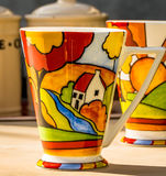 Brightly Coloured Coffee Mugs. Bright, summery, multi coloured coffee mugs in porcelain, with an art deco, vintage design and style Royalty Free Stock Photography