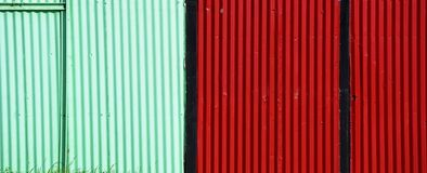 Brightly coloured corrugated fence. Bright colours. Bright colors stock photos
