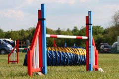 A brightly coloured dog agility sport jump Royalty Free Stock Images