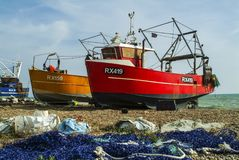 Brightly-coloured fishing boats of the Hastigns Fleet royalty free stock photo