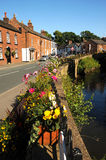 Brightly coloured floral baskets in the pretty English floral village of Croston Royalty Free Stock Photo