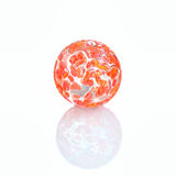 Brightly coloured glass marble Royalty Free Stock Photography