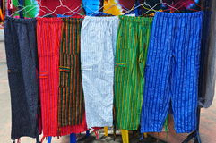 Brightly coloured handmade trousers Stock Images