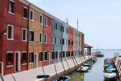 Brightly coloured houses and boats. On the island of Burano royalty free stock photography