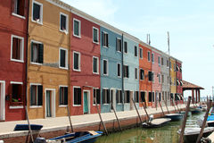 Brightly coloured houses and boats. On the island of Burano stock photography