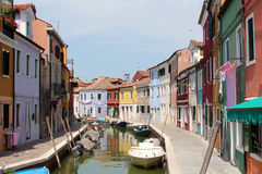 Brightly coloured houses and boats. On the island of Burano stock photo