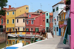 Brightly coloured houses and boats. On the island of Burano stock image