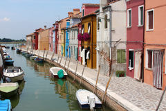 Brightly coloured houses and boats. On the island of Burano royalty free stock photos