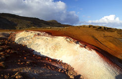 Brightly coloured mud deposits at Seltun Royalty Free Stock Image