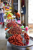 Brightly coloured pickled Chinese Dates sold with other fruits by Vendor along the outdoor corridor of Bogyoke Market Royalty Free Stock Photography