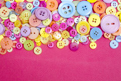 Brightly coloured retro and vintage plastic buttons Royalty Free Stock Image