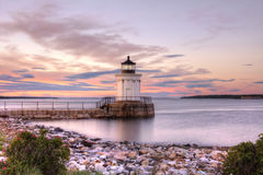 Brightly coloured skies reflect off the Bug Light in Portland, Maine. Stock Images