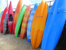 Brightly coloured stacked kayaks Stock Photography