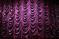 Brightly curtains in theatre. Brightly lit curtains in theatre Royalty Free Stock Images