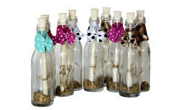 Brightly Decorated Bottles Containing Scrolled Messages. Brightly declorated bottles containing scrolled messages Royalty Free Stock Images