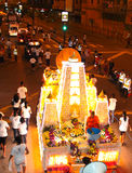Brightly decorated floats parading at Wesak Stock Images