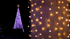 Brightly decorated with garlands Christmas tree adorning central square of city. Stock footage stock video