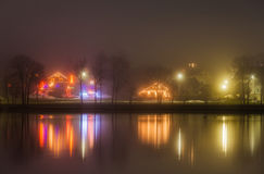 Brightly decorated houses near lake Stock Photos