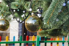 Brightly Decorated New Year tree at street Stock Image