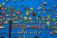 A brightly Decorated Wall Mosaic. Found in a community garden in St Kilda Melbourne, a brightly coloured wall with colourful artwork of fish, flowers, animals Stock Images