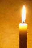 Brightly flaring candle Stock Photography