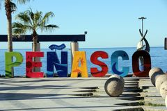 Brightly coloured sign at EL Malecon, Puerto Penasco, Mexico. Brightly laid out letters spelling the name Penasco as  you walk along the Malecon at the edge of Royalty Free Stock Photo