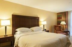 Brightly lit bedroom Stock Photos