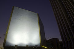 Evening Blank Billboard. Brightly lit blank billboard stands out from the downtown area around at the early evening hours. Good as copy space for demonstrations Stock Photography