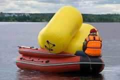 Brightly lit boat with wings with buoys and man . royalty free stock photos