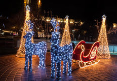 Brightly lit Christmas sled Stock Photos